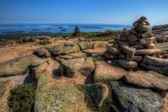 """Cairns, or piles of rocks, mark the trail on Cadillac Mountain overlooking Bar Harbor, Maine. The photographer wrote, """"Cadillac Mountain is largely composed of pink granite with forests of spruce and pitch pine. Views of Acadia National Park from the top of the mountain are spectacular."""" Photo by Princess Stand in the Rain  www.fourpointsbangorairport.com"""
