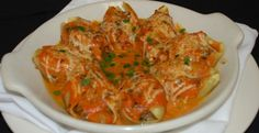 Stuffed Shells Bolognese Recipe with a Tomato Cream Sauce.  I might play with this to add spinach or walnuts or both.