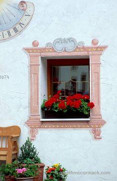 Ornate painted window, Neustift im Stubaital, Tirol, Austria. Stock Photo