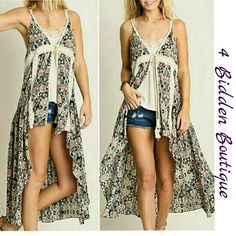 BOHO HI-LO VEST WITH LACE TRIM NEW FLORAL PRINT HIGH LOW VEST. GORGEOUS LACE TRIM. TIE CLOSURE.  AVAILABLE IN SMALL OR MEDIUM 65% Cotton/35% Polyester Price is final 4 Bidden Boutique Tops