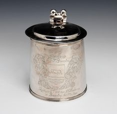 A Charles II silver tankard by Edward Mangie, Hull, circa the cover and body each stamped twice with maker's mark and the town mark, Baronet, Catholic Religion, The Rev, Tumbler Cups, Roman Catholic, Coat Of Arms, Makers Mark, Two By Two, Auction