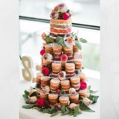 Mini cakes for the big cake? Talk about a trend that lets us have our cake AND eat it too! Wedding Planning Tips, Budget Wedding, Wedding Tips, Wedding Planner, Unique Wedding Favors, Unique Weddings, Backyard Wedding Lighting, Uk Recipes, Naked Cake