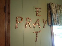 we cut letter out of wood, I painted them brown & aligned each one with pennies... hey mom kenzie alana and i helppe too!! :) -from alexis :)