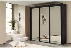 Imperial - Three door all mirrored robe.