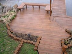 Pretty boat dock with bench. Stairs leading down to lower deck and boat dock.  Buckeye Exteriors, LLC. Deck contractors for Akron, Ohio, Cleveland, and Northeast Ohio.
