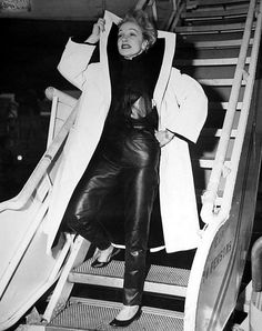 """""""I dress for the image. Not for myself, not for the public, not for fashion, not for men."""" – Marlene Dietrich.  Photo: 1954 (at Idlewild Airport in New York)  Bizarre Los Angeles"""