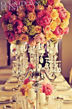 colourful round floral arrangement on crystal candelabra