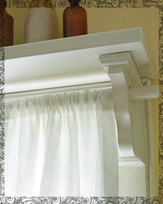 Bracket curtain rod Love this! Over patio door with colorful things on shelf!!