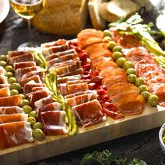 Great presentation of delicious cured meats and olives. Add some crusty bread, figs and cheese drizzled with honey...