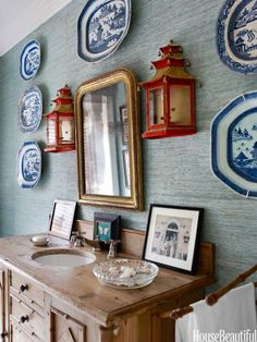 In the powder room, an antique sideboard became a vanity. Walls are covered in Phillip Jeffries's Seagrass grass cloth. http://www.housebeautiful.com/design-inspiration/house-tours/g1432/liza-pulitzer-calhoun-florida-house-0613