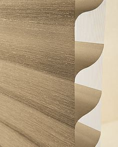 Silhouette Window Shadings come in twelve different fabrics with 115 colors to choose from. Here is a close up of an Alustra Silhouette, from Hunter Douglas' premium luxury collection.