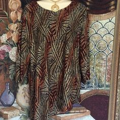 New Listing! Stunning Tunic! Stunning Chico's Top\Tunic. Geometric Pattern in black, browns, reds, mauves and creams. Excellent like new condition, worn once. Chico's size 2 = misses 10-12. Great with mini or leggings and boots! 3/4 sleeves. Chico's Tops Tunics