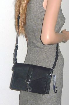 Rebecca Minkoff Nwt Hudson Moto Mini Dust Cover Black Cross Body Bag. Get the trendiest Cross Body Bag of the season! The Rebecca Minkoff Nwt Hudson Moto Mini Dust Cover Black Cross Body Bag is a top 10 member favorite on Tradesy. Save on yours before they are sold out!