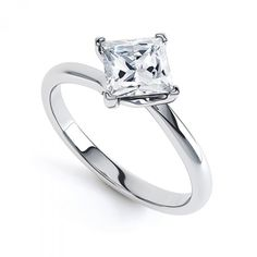 ND1006 - Princess 4 Claw Twist. Princess cut diamond ring on a delicate twist. A fine shank emphasise the beautiful compass setting allowing the maximum light to light the fire of your princess cut diamond