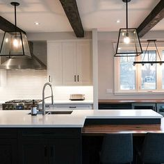 With a bar station and tons of seating, this kitchen is made for hosting! Oakville Kitchen and Bath Centre designed the perfect focal point: a layered Calacatta Nuvo island.