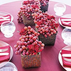 Update the classic Thanksgiving cornucopia concept with this easy  centerpiece of fruit and flowers.