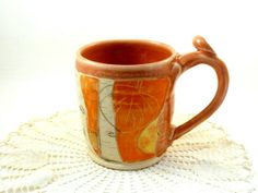 Ceramic coffee cup in peach and pumpkin MADE by BlueSkyPotteryCO, $35.00