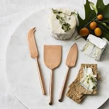 This trio of copper-plated knives adds a luxurious touch to cheese and appetizer trays. Shaped to slice and serve a range of cheeses, it includes a pointed-blade knife for hard cheese, a curved spreader for soft cheese and skewering charcuterie, a… Wine Recipes, Food Network Recipes, Marble Cheese Board, Cheese Boards, Global Knife Set, Cheese Knife Set, Unique Housewarming Gifts, Unique Gifts, Cheese Lover