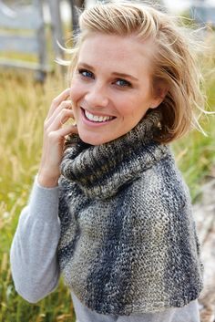 Knitted shoulder cape for women with deep roll neck collar. Shop this knitting pattern at The Knitting Network now