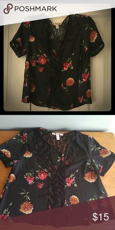 Short Sleeve Blouse Black, flowy short sleeve shirt with dark yellow and magenta colored flowers. Translucent black lace going down the middle of shirt and collarbone/shoulders and lace trim on the sleeves. Forever 21 Tops Blouses