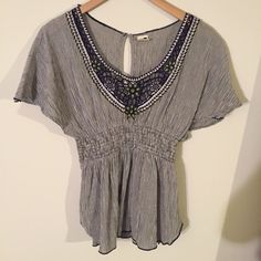 {freepeople} peasant top Woven flutter sleeve woven top with embroidery neckline. Back keyhole detail closure. Navy and white striped. Free People Tops Blouses