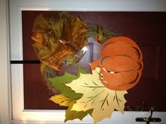 Thanksgiving wreath! Placemats $1.99 each at bed bath and beyond  Ribbon and wreath $12 total at Joann's Sew placemats onto each other then onto wreath. Make a large bow with rubber bands and tie to wreath. Voila! Thanksgiving door decor!