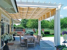 love the use of shades on this pergola...could be removed in fall/winter to allow more light.