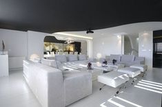 The Spanish Architecture firm is one of my favorite designers and this interior is no exception.  So much white though.