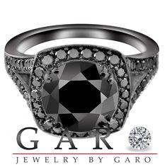 2.95 Carat CERTIFIED Fancy Black Diamonds Engagement Ring Vintage Style 14K Black Gold Pave Set. $2,800.00, via Etsy.