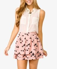 Sleeveless Sheer Shirt tucked into Pink Bird Skirt