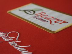 Embroidery:  Casemade material is machine embroidered with custom artwork.  The material is then glued and wrapped around board to create a binder, slipcase, padholder, or other casemade product.