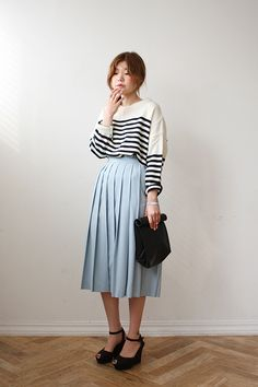 Striped sweater and pleated midi skirt from Eat Me! Bread and Butter #fashion