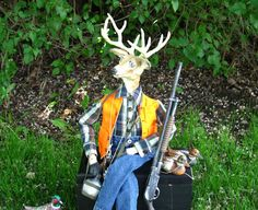 My Deer Hunter doll with his accessories and his reversible hunter vest with safety orange on the outside.