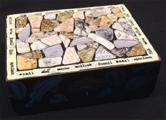 Upcycled wooden box from thrift store with faux sea glass on top backed by scrap papers with an oceanic theme. Rubber stamped around the edges and on the sides. By Carolyn Hasenfratz. Learn how to make a similar box here - http://carolynsstampstore.com/catalog/mosaic_box.php