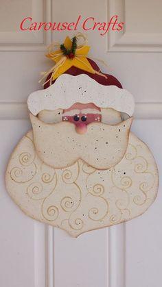 Cute Santa wood craft. Hanging wood craft for the Christmas holidays. Santa face