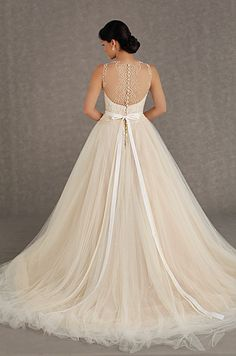 We are obsessed with this blush tulle wedding dress and it's incredible beading detail. Veluz Reyes, Fall 2013