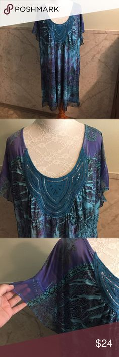 """One World Stretchy & Satiny Tunic/Dress Sheer Trim This is an absolutely beautiful dress by One World in a size 3x. You can wear it as a tunic or a dress. It's 38"""" long. I'm 5'5"""" and it comes to my knees. The trim of the hem and sleeves is sheer. The front is decorated with shiny sequins. The material feels satiny but it's stretchy. It's made from polyester and spandex. ONE WORLD Dresses Mini"""