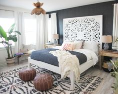Tree cut out headboard, patterned rug, accent wall, to plant. Yes please.