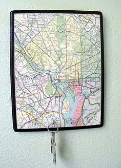 modpodge map on wood and then add hooks - maybe put a quote/phrase on top of the map!