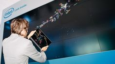 """Intel / Gliders Installation. Using Ultrabooks to easily create characters or """"gliders"""" and do some basic customization and flick it to a larger screen to play with all the other creations. Also being able to view first person of your character that's up on the big screen."""