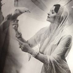 Indira Devi of Cooch Behar, a princess in her own right from Baroda, and married to the Maharaja of Cooch Behar, photographed here by Cecil Beaton. Note her wide deco bracelets and long girandole natural pearl and diamond ear pendants #GreatJewelryCollectors