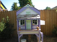 "Chicken coop. My Brother in law made and I painted. The sign says ""The Happy Hen B&B, rooms for cheep cheep"""