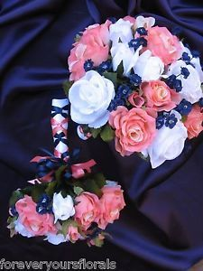 Created with gorgeous Coral Reef Roses, White Roses & Navy Baby's Breath, this gorgeous Navy and Coral Set is finished with White,  Coral and Navy Satin. Designed to match David's Bridal Coral Reef color, this set comes in a variety of other colors.