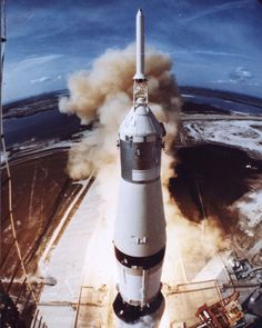 """July 16, 1969: Apollo 11 launched on the first mission to land humans on the Moon. The Saturn V rocket lifted off from NASA's Kennedy Space Center with astronauts Neil A. Armstrong, Michael Collins, and Edwin """"Buzz"""" Aldrin at 9:32 am EDT."""