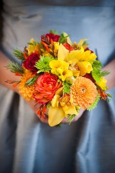 Not right -- too much yellow?  also small - not sure if it is angle of picture or just compactly placed   Green Orange Red Yellow Bouquet Fall Wedding Flowers Photos & Pictures - WeddingWire.com