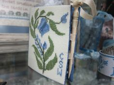 Carolyn has magic fingers! She took the Workbasket free designs - pink basket and blue basket - and worked them into this wonderful book...