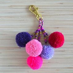 Pom pom keychain charm bag tassel keychain tassel charm purse Source by betediasguimar Tassel Keychain, Diy Keychain, Tassel Purse, Pom Pom Crafts, Yarn Crafts, Pom Pom Bag Charm, Pom Pom Keyrings, Creative Crafts, Crafts To Make
