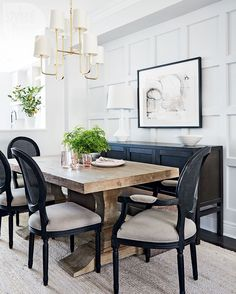 In the dining room, a rough-hewn farm table paired with classic chairs achieves elegance; a bench that can slide beneath the table makes the most of the small space and a panelled feature wall adds visual interest. | Image: Stacey Brandford | Styling: Stacy Begg