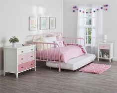 The Monarch Hill daybed with handy pull-out trundle is the perfect sleep solution. The sturdy metal frame is made especially for kids and built to withstand years of everyday wear and tear, and also features a slat system that provides extra support. The intricate scroll design and rounded edges add a touch of whimsy and comes in your choice of white, pink or black—ideal for any room! Prop the daybed with cushions for a handy place to sit and read, do homework or play by day, then tuck in at…