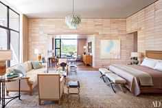 """""""When the palette of a project goes more neutral, I like to add pops of color with accessories, especially lamps and chandeliers. I find that turquoise works well in monochromatic settings.""""   At a home in the Arizona desert, decorator Jan Showers used subtle blue accessories to play off the master bedroom's limestone-brick walls."""